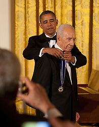 President Barack Obama awards the Presidential Medal of Freedom to Israeli President Shimon Peres during a dinner in his honor in the East Room of the White House in Washington on June 13, 2012. Photo by Martin H. Simon/ABACAPRESS.COM