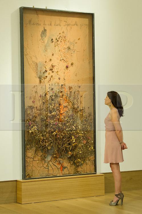 © London News Pictures. 26/06/15. London, UK. A Bonham's employee looks up Anselm Kiefer's 2005 'Maria durch den Dornwald ging', which is part of Bonhams Contemporary Art Sale, New Bond Street, Central London. Photo credit: Laura Lean/LNP
