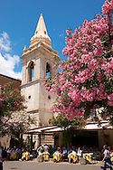 Cafe and church of St. Guiseppe on the Plaza ix Aprile with trees in blossom - Taormina, Sicily .<br /> <br /> Visit our SICILY PHOTO COLLECTIONS for more   photos  to download or buy as prints https://funkystock.photoshelter.com/gallery-collection/2b-Pictures-Images-of-Sicily-Photos-of-Sicilian-Historic-Landmark-Sites/C0000qAkj8TXCzro