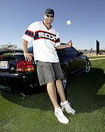 Chicago White Sox pitcher Mark Buehrle poses with his Mustang during spring training in Tucson, Arizona on March 3, 2004. (Photo by Ron Vesely).