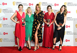 Morgana Robinson and cast members of Morgana Robinson's Summer with their award for Short Form Programme alongside Sharon Horgan (right) in the press room at the Virgin TV British Academy Television Awards 2018 held at the Royal Festival Hall, Southbank Centre, London.