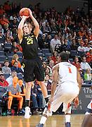 Dec. 17, 2010; Charlottesville, VA, USA; Oregon Ducks forward E.J. Singler (25) shoots the ball over Virginia Cavaliers guard Jontel Evans (1) during the first half of the game at the John Paul Jones Arena. Mandatory Credit: Andrew Shurtleff