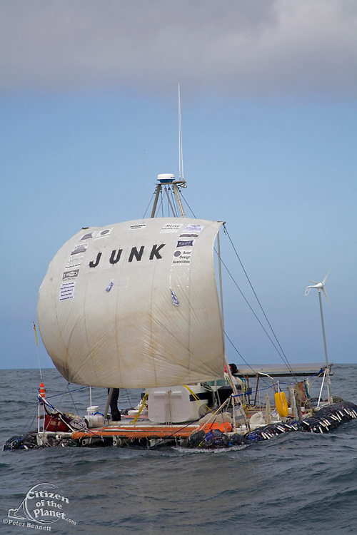 """On the third day of the trip the """"Junk"""" sets sail about 65 miles from shore. Pictured is Joel Paschal. On Sunday June 1, the raft named """"Junk""""  left Long Beach for it's 2100 mile voyage to Hawaii to bring attention to the plastic marine debris (nicknamed the plastic soup) accumulating in the North Pacific Gyre. The raft was designed and will be sailed by Dr. Marcus Eriksen of the Algalita Marine Research Foundation, and Joel Paschal, it is constructed from 15,000 plastic bottles, an airplane fuselage, discarded fishing nets and a solar generator. The raft was towed for two and a half days to near San Nicholas Island, about 65 mile of the coast of California, so it could catch favorable winds for it's trip. The tow boat was the ORV Alguita, captained by Charlie Moore of the Algalita Marine Research Foundation, the man credited for first discovering the plastic soup in the Gyre over 12 years ago."""