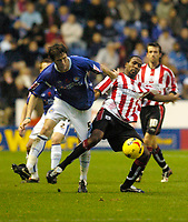 Photo: Leigh Quinnell.<br /> Leicester City v Southampton. Coca Cola Championship.<br /> 05/11/2005. Leicesters Patrick McCarthy battles with Southamptons Ricardo Fuller.