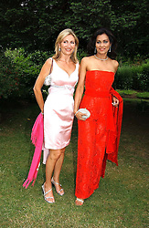 Left to right, KAREN PHILLIPS and WILIMINA FORSYTH wife of Bruce Forsyth at a fund raising event for The Galapagos Conservation Trust entitled 'Some Enchanted Evening' at the Chelsea Physic Garden Chelsea, London on 17th June 2004.