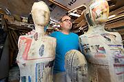 Jose Chavaria poses for a portrait in his Piñata shop in Phoenix, AZ.
