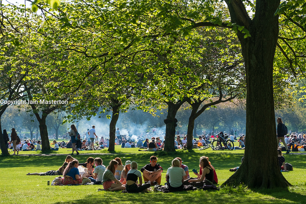 Edinburgh, Scotland, UK. 14 May 2019. Warm sunny weather in the capital brought hundreds of people to The Meadows park in the afternoon to enjoy the sun. The park is adjacent to Edinburgh University and it seemed that most of the crowd were students taking a break from studying for upcoming exams