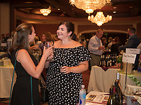 """Caitlyn Deschenes and Olivia Schadlick share a """"toast"""" with a Rose from the Treasury Wine Estate during Thursday evening's Winnipesaukee Wine Festival at Church Landing in Meredith.  (Karen Bobotas/for the Laconia Daily Sun)"""