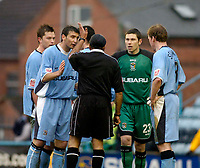 Photo. Glyn Thomas. 22/02/2005.<br /> Coventry City v Stoke City. Coca Cola Championship.<br /> Coventry players including Ian Bennett (second from R) surround referee Jarnail Singh after Bennett was shown the red card for handling the ball outside the penalty area.
