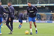 AFC Wimbledon defender Terell Thomas (6) and AFC Wimbledon coach Steven Reid warming up during the EFL Sky Bet League 1 match between AFC Wimbledon and Southend United at the Cherry Red Records Stadium, Kingston, England on 24 November 2018.