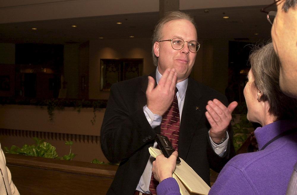 Des Moines, Iowa 24JAN 2000: Bush media strategist Karl Rove spins the press at the Marriott Hotel 1-24-00.  © Bob Daemmrich  /