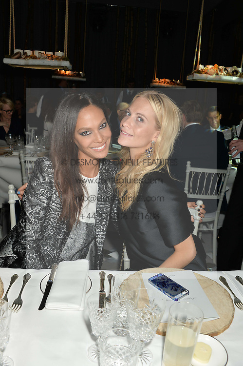 Left to right, JOAN SMALLS and POPPY DELEVINGNE at a Dinner to celebrate the launch of the Mulberry Cara Delevingne Collection held at Claridge's, Brook Street, London on 16th February 2014.