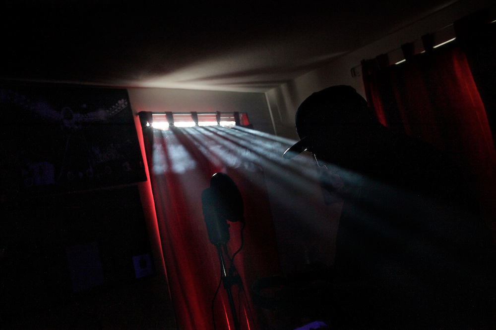 """""""Black lights producing harps from heaven."""" Light filters in from outside revealing the silhouette of Robert Pigozzi, a.k.a. """"Wizeass,"""" as he records a mixed tape in a marijuana haze at the home of Ernie Bordon, a.k.a. """"EbGb,"""" in East Naples."""
