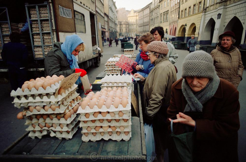 Shoppers buy eggs from a street vendor in winter in Prague, Czech Republic.