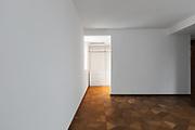 Empty bedroom with door leads into walk-in closet. Nobody inside