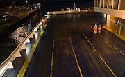Two seaman walking on cargo deck of Stena night ferry, Harwich, Essex, England