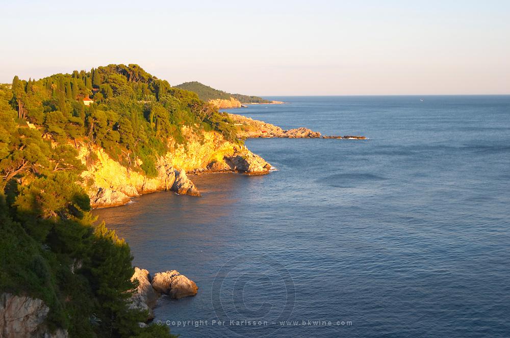 View over rock and cliff formations on the Babin Kuk peninsula. Uvala Sumartin bay between Babin Kuk and Lapad peninsulas. Dubrovnik, new city. Dalmatian Coast, Croatia, Europe.