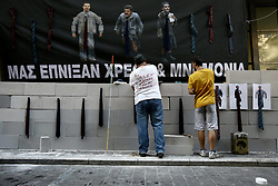 June 16, 2017 - Athens, Greece - Workers at public hospitals build a wall blocking the entrance of the Finance Ministry, protesting spending cuts in health care. In Athens on June 16, 2017  (Credit Image: © Panayotis Tzamaros/NurPhoto via ZUMA Press)