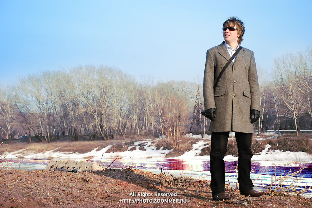 Illustration of ecological problems. Photo of polluted river and a man in front