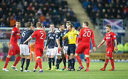 Ref Willie Collum holds back Falkirk's Tom Taiwo and Rangers Kyle Hutton. Falkirk 1 v 1 Rangers, Scottish Championship game played 27/2/2014 at The Falkirk Stadium .