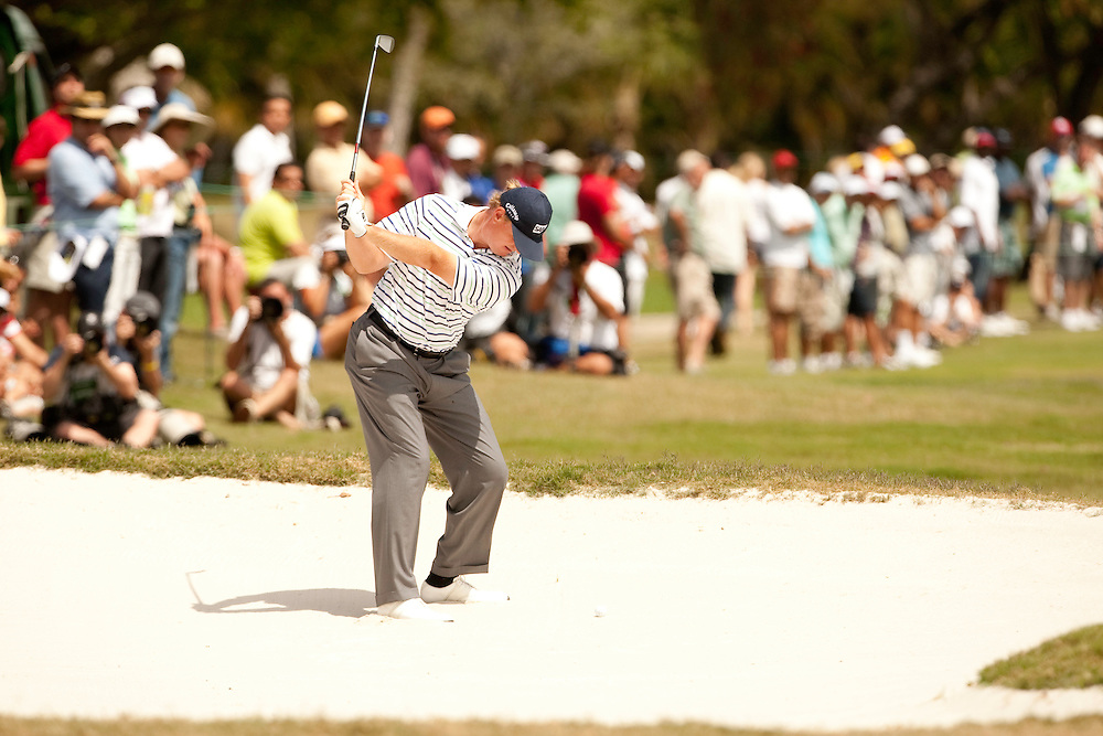 DORAL, FL - MARCH 15:  Ernie Els hits his bunker shot in front of the gallery during the fourth round of the 2009 WGC-CA Championship at Doral Golf Resort and Spa in Doral, Florida on Sunday, March 15, 2009. (Photograph by Darren Carroll) *** Local Caption *** Ernie Els