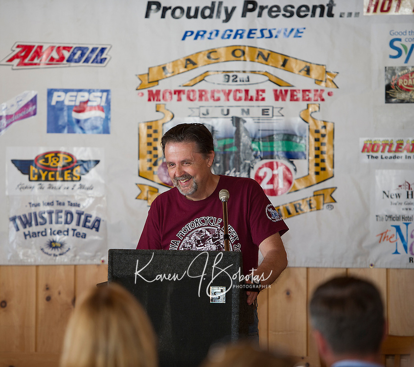 Mayor Ed Engler welcomes distinguished guests during the Motorcycle Week 2015 kickoff event at Faro Restaurant in Weirs Beach on Thursday morning.  (Karen Bobotas/for the Laconia Daily Sun)