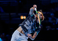 Tennis - 2019 Nitto ATP Finals at The O2 - Day Seven<br /> <br /> Semi Finals: Stefanos Tsitsipas (Greece) Vs. Roger Federer (Switzerland) <br /> <br /> Stefanos Tsitsipas (Greece) with the follow through  following his serve <br /> <br /> COLORSPORT/DANIEL BEARHAM<br /> <br /> COLORSPORT/DANIEL BEARHAM