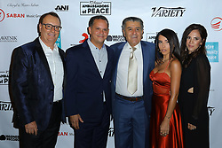 David Renzer, Haim Saban, Chesck and guest at Creative Community For Peace 2nd Annual 'Ambassadors Of Peace' Gala held at Los Angeles on September 26, 2019 in Private Residence, California, United States (Photo by © Jc Olivera/VipEventPhotography.com