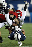 BYU wide receiver Ross Apo, right, is upended by Utah linebacker Chaz Walker, left, after catching a 7-yard Jake Heaps pass during the second half of an NCAA college football game, Saturday, Sept. 17, 2011, at LaVell Edwards Stadium in Provo, Utah. Utah defeated BYU 54-10. (AP Photo/Colin E Braley)....