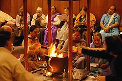 Women worshippers at Hindu temple during Havan Ceremony,