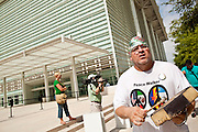 15 JULY 2010 - PHOENIX, AZ: William Robles (CQ), from Guadalupe, dances against SB 1070 in front of the courthouse Thursday. People for and against SB 1070 picketed the front of the Sandra Day O'Connor US Courthouse (CQ) in Phoenix Thursday morning during the first hearing against SB 1070.    PHOTO BY JACK KURTZ