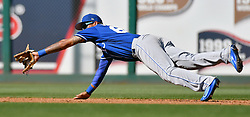 March 7, 2017 - Goodyear, AZ, USA - Kansas City Royals shortstop Humberto Arteaga makes a diving catch for an out on the Cincinnati Reds' Desmond Jennings during spring training at Goodyear Ballpark in Goodyear, Ariz., on Tuesday, March 7, 2017. The Reds won, 7-3. (Credit Image: © John Sleezer/TNS via ZUMA Wire)