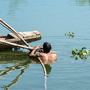 Man preparing boat for fishing in Hue river