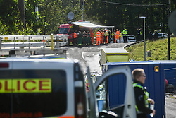© Licensed to London News Pictures. 08/08/2020. City, UK. Emergency services at the scene of the freight train accident in Llangennech, near Llanelli in Wales. The train was carrying a vast amount of diesel fuel which caused a huge fire and spilled into nearby waterways. The fire is still ablaze and the fire service continue to contain it into the evening. Photo credit: Robert Melen/LNP