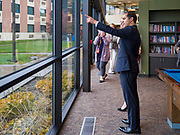 01 NOVEMBER 2019 - DES MOINES, IOWA: JULIAN CASTRO, former Secretary of Housing and Urban Development in the Obama Administration, looks at the common room and courtyard in the YMCA Supportive Housing Campus. Secretary Castro, who is running for the Democratic nomination for the US presidency, toured the YMCA Supportive Housing Campus in downtown Des Moines Friday. The campus is the only project of its type in the US. It provides transitional housing in the form of individual apartments (rather than dorms) for at risk people rent is needs tested so poverty does not prevent people from getting apartments. There are about 140 apartments in the complex, the YMCA has a waiting list of 119 people. Castro toured the campus before he spoke at the Liberty and Justice Celebration downtown.      PHOTO BY JACK KURTZ
