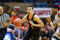 Jan 12, 2019; Morgantown, WV, USA; Oklahoma State Cowboys guard Thomas Dziagwa (4) drives down the lane during the first half against the West Virginia Mountaineers at WVU Coliseum. Mandatory Credit: Ben Queen-USA TODAY Sports