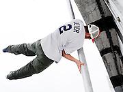 Breakdancer standing on a streetlamp