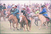 Trainers & jockeys at race<br /> Naadam horse race<br /> Jockey's aged 4-12 years and most often girls<br /> Ulaanbaatar race track<br /> Mongolia