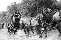 File photo dated 17/09/83 of experienced horse driver the Duke of Edinburgh looking anxious as he gets into trouble at the obstacle pond during the Famous Grouse National Carriage Driving Championships at Smith's Lawn. He was the Queen's husband and the royal family's patriarch, but what will the Duke of Edinburgh be remembered for? Issue date: Friday April 4, 2021.