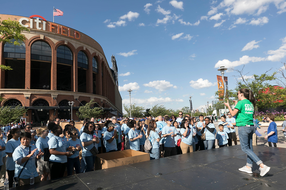 Citibank help City Harvest repack apples at Citifield on June 2, 2017 in New York City. (Photo by Ben Hider)