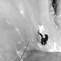 Roger Schley ice climbs in Lee Vining Canyon in the Sierra Nevada near Yosemite National Park, California.  c. 1975