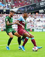 Football - 2019 Betway Cup (pre-season friendly) - West Ham vs. Athletic Bilbao<br /> <br /> West Ham United's Sebastien Haller holds off the challenge from Athletic Club's Unai Nunez, at The London Stadium.<br /> <br /> COLORSPORT/ASHLEY WESTERN