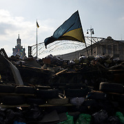 KIEV, UKRAINE - February 24, 2014: An Ukrainian flag is seen a top of one of the remaining barricades in Kiev's Independence Square. CREDIT: Paulo Nunes dos Santos