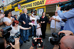 UK ENGLAND LONDON 19AUG11 - Media cover the re-opening ceremony of Siva Kandiah's convenience store in Clarence Road, Hackney, east London. Local shopkeeper Siva Kandiah ran the Clarence Convenience Store for 11 years - and had to watch as it was ransacked and destroyed, leaving him with no stock, no money in the till, and no store. During the August riots in London, Clarence Road in Hackney featured some of the most devastating scenes of looting and violence...jre/Photo by Jiri Rezac..© Jiri Rezac 2011