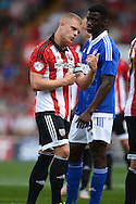 Jake Bidwell, the Brentford captain looks on. Skybet football league Championship match, Brentford v Ipswich Town at Griffin Park in London on Saturday 8th August 2015.<br /> pic by John Patrick Fletcher, Andrew Orchard sports photography.