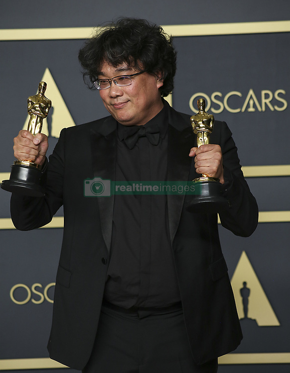 """February 9, 2020, Hollywood, California, USA: Director Bong Joon-ho, winner of the Original Screenplay, International Feature Film, Directing, and Best Picture awards for """"Parasite,"""" poses in the press room of the 92nd Academy Awards on Sunday February 9, 2020 at the Dolby Theater in Hollywood, California. BURT HARRIS/BNS/PI (Credit Image: © Prensa Internacional via ZUMA Wire)"""