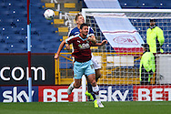 Lukas Jutkiewicz of Burnley and Michael Morrison of Birmingham City challenge for the ball. Skybet football league championship match, Burnley  v Birmingham City at Turf Moor in Burnley, Lancs on Saturday 15th August 2015.<br /> pic by Chris Stading, Andrew Orchard sports photography.