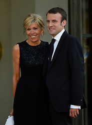French Minister of Economy, Recovery of Productivity and Digital Affairs Emmanuel Macron and wife Brigitte Trogneux arriving at the Elysee Palace for a state dinner in honor of King Felipe VI and Queen Letizia of Spain, in Paris, France on June 2, 2015. The Spanish royal couple, who cut short their March 2015 state visit to France after a Germanwings Airbus crashed in the French Alps killing 45 Spanish citizens, are on a three-day official state visit to France. Photo by Christian Liewig/ABACAPRESS.COM