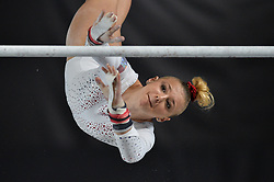 October 4, 2017 - Montreal, Quebec, Canada - LORETTE CHARPY, from France, competes on the uneven bars during the third day of qualifying competition held at the Olympic Stadium. (Credit Image: © Amy Sanderson via ZUMA Wire)