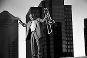 Trombone player Lil' Joe Burton stands on an Atlanta rooftop.